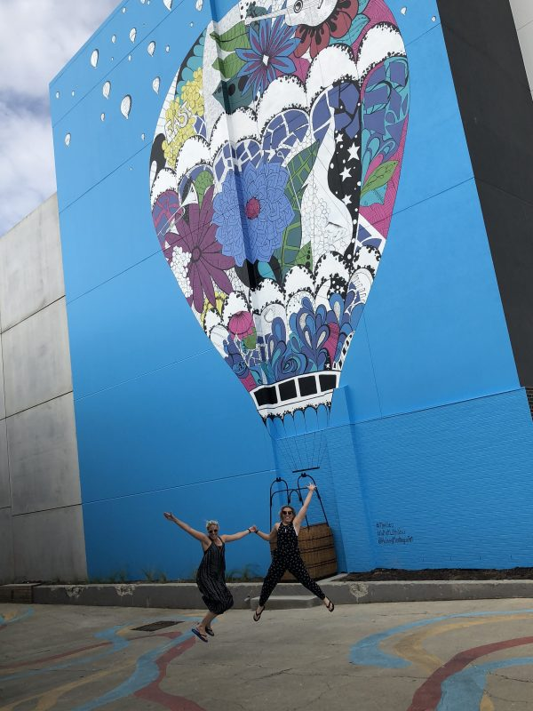 International Street Artist Kelsey Montague Commissioned to Create an Interactive Hot Air Balloon Mural at the Mary Pickford Theatre